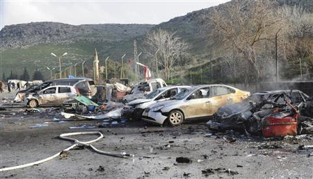 Damaged cars are seen after an explosion at Cilvegozu border gate near the town of Reyhanli on the Turkish-Syrian border in Hatay province February 11, 2013, in this picture taken by Anadolu Agency. REUTERS/Cem Genco/Anadolu Agency