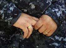 Navy Counselor 1st Class Luz Bautista, a lesbian whose partner is also in the military, poses for a photo in Los Angeles, California September 20, 2011. REUTERS/Lucy Nicholson