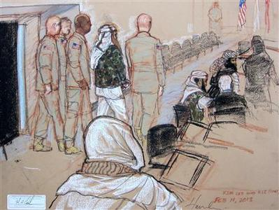 In this Pentagon-approved courtroom sketch, alleged 9/11 mastermind Khalid Sheikh Mohammad is brought to court with a four-man escort at Guantanamo Bay U.S. Naval Base, Cuba, February 11, 2013. REUTERS/MANDATORY CREDIT:Janet Hamlin