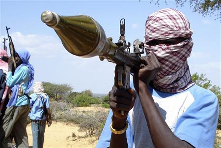 A militia from Somalia's Islamic Union Courts (ICU) holds up a rocket propelled grenade (RPG) during training on the outskirts of Mogadishu, in this December 11, 2008 file photo. REUTERS/Mowlid Abdi/Files