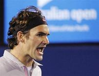 Roger Federer of Switzerland reacts during his men's singles semi-final match against Andy Murray of Britain at the Australian Open tennis tournament in Melbourne January 25, 2013. REUTERS/Daniel Munoz
