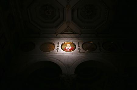 An image of Pope Benedict XVI is seen displayed at St. Paul's Outside the Walls basilica in Rome February 11, 2013. REUTERS/Alessandro Bianchi
