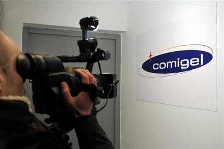 A television cameraman makes images outside the Comigel offices in Metz eastern France, February 8, 2013. REUTERS/Alexandre Marchi