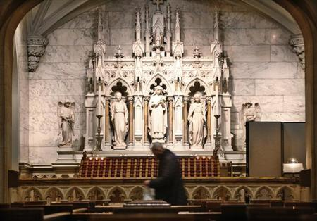 A man walks through St. Patrick's Cathedral during mass in New York, February 11, 2013. REUTERS/Brendan McDermid
