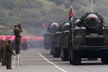 A North Korean soldier films military vehicles carrying missiles during a parade to commemorate the 65th anniversary of founding of the Workers' Party of Korea in Pyongyang October 10, 2010. REUTERS/Petar Kujundzic/Files