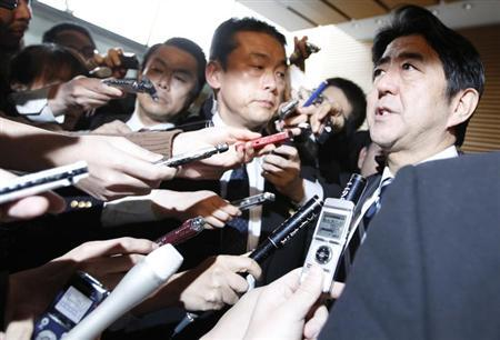 Japan's Prime Minister Shinzo Abe (R) speaks to media after attending a meeting of Security Council of Japan at his official residence in Tokyo February 12, 2013 after reports of North Korea's possible nuclear test. REUTERS/Issei Kato