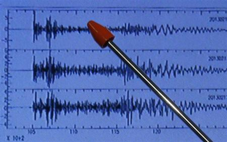 Japan Meteorological Agency's earthquake and tsunami observations division director Akira Nagai points at a graph of ground motion waveform data observed in the morning in Japan during a news conference in Tokyo February 12, 2013. REUTERS/Toru Hanai
