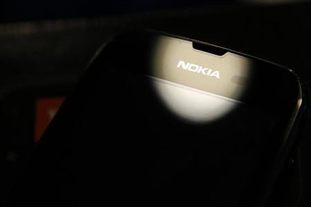 A Nokia smartphone is seen in this photo illustration taken in Bucharest January 24, 2013. REUTERS/Bogdan Cristel
