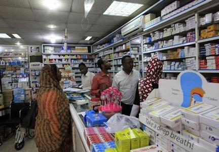 A customer buys medication at a pharmacy in Khartoum January 13, 2013. REUTERS/Mohamed Nureldin Abdallah