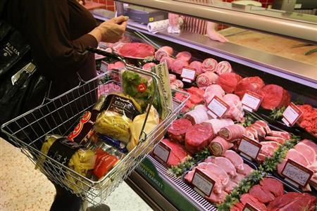A customer shops at a Morrisons store in Welling, south east London November 24, 2009. REUTERS/Stefan Wermuth