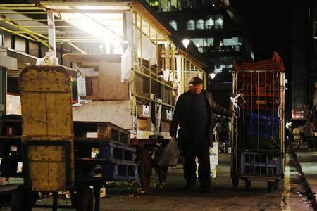A market trader packs up his stall in London November 13, 2012. REUTERS/Luke MacGregor