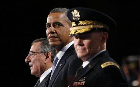 U.S. President Barack Obama attends the Armed Forces Farewell Tribute in honor of Defense Secretary Leon Panetta (L) at Joint Base Myer-Henderson in Washington February 8, 2013. At right is Chairman of the Joint Chiefs of Staff General Martin Dempsey. REUTERS/Kevin Lamarque (UNITED STATES - Tags: POLITICS MILITARY) - RTR3DIM0