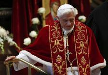 Pope Benedict XVI leaves at the end of a mass at the St. Peter's Basilica in the Vatican February 9, 2013. REUTERS/ Alessandro Bianchi