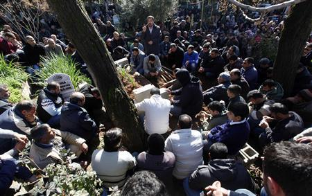 People attend the funeral of Ahmet Tas, 35, one of the 13 victims who died during an explosion at a crossing on Turkey's border with Syria, in the town of Reyhanli on the Turkish-Syrian border in Hatay province February 12, 2013. REUTERS/Umit Bektas