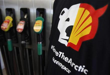 A T-shirt of a Greenpeace environmental activist is seen next to gas pumps at a Shell gas station in Prague in this May 10, 2012 file photo. REUTERS/David W Cerny/Files