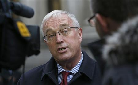 Union Cycliste Internationale (UCI) President Pat McQuaid speaks to reporters as he leaves a procedural hearing in London January 25, 2013. REUTERS/Suzanne Plunkett