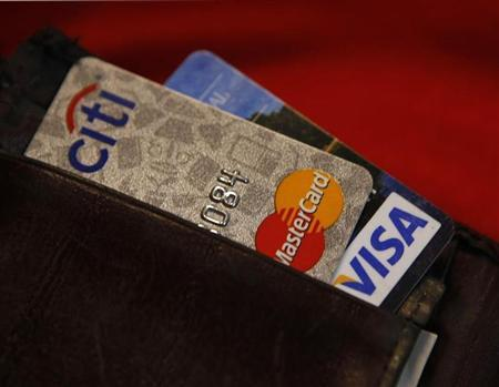 Credit cards are pictured in a wallet in Washington, February 21, 2010. REUTERS/Stelios Varias (UNITED STATES - Tags: BUSINESS) - RTR2AOJQ
