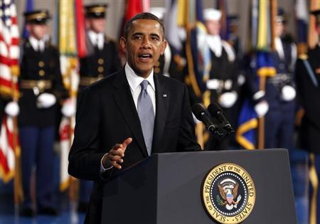 U.S. President Barack Obama speaks at the Armed Forces Farewell Tribute in honor of Defense Secretary Leon Panetta at Joint Base Myer-Henderson in Washington February 8, 2013. REUTERS/Kevin Lamarque