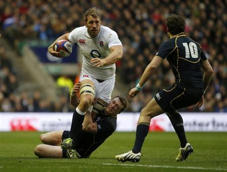 England's Chris Robshaw is tackled by Scotland's Tim Visser (C) and Ruaridh Jackson during their Six Nations international Rugby Union match at the Twickenham Stadium in London February 2, 2013. REUTERS/Eddie Keogh