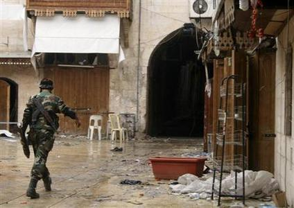 A Free Syrian Army fighter walks in the old city of Aleppo February 11, 2013. Picture taken February 11, 2013. REUTERS/Aref Heretani