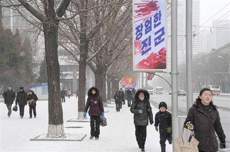 North Koreans walk on a street in Pyongyang February 12, 2013, on the day North Korea conducted its third nuclear test, in this photo taken by Kyodo. REUTERS/Kyodo