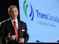 Russ Girling, president and CEO of TransCanada, talks to a shareholder before the company's annual general meeting in Calgary, Alberta in this April 27, 2012, file photo. REUTERS/Todd Korol/Files