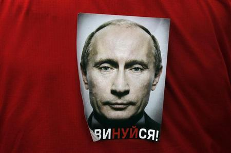 A participant wears a sticker with the word ''Obey!'' during an opposition protest on Revolution square in central Moscow February 26, 2012. REUTERS/Denis Sinyakov