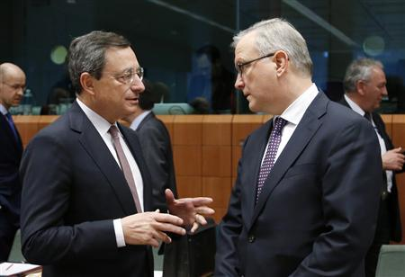 European Central Bank (ECB) President Mario Draghi talks to European Economic and Monetary Affairs Commissioner Olli Rehn (R) during an euro zone finance ministers meeting at the European Union Council in Brussels February 11, 2013. REUTERS/Francois Lenoir