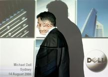 Founder and chairman of Dell computers Michael Dell passes a screen projection before speaking at a news conference in Sydney August 14, 2006. REUTERS/Will Burgess
