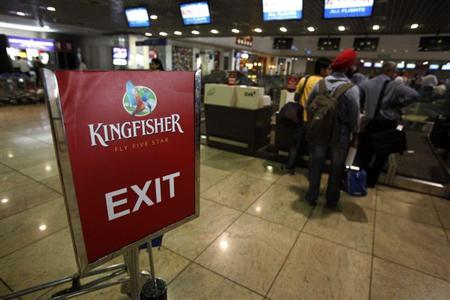 Kingfisher Airlines customers wait in a check-in queue at Mumbai's domestic airport March 20, 2012. REUTERS/Vivek Prakash
