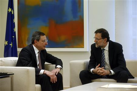 European Central Bank (ECB) President Mario Draghi (L) talks to Spanish Prime Minister Mariano Rajoy at the start of their meeting at Madrid's Moncloa Palace February 12, 2013. Draghi said on Tuesday Spain was on the right track towards economic recovery and he saw several positive signs. REUTERS/Susana Vera