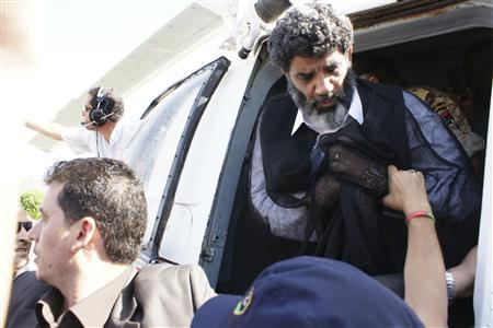 Muammar Gaddafi's former spy chief Abdullah al-Senussi (R) arrives in Tripoli September 5, 2012. REUTERS/Libyan National Guard/Handout