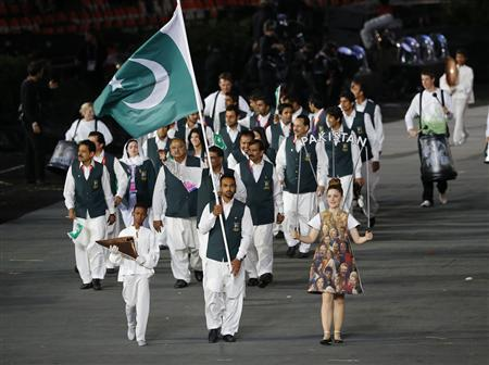 Pakistan's flag bearer Sohail Abbas (C) holds the national flag as he leads the contingent in the athletes parade during the opening ceremony of the London 2012 Olympic Games at the Olympic Stadium July 27, 2012. REUTERS/Mike Blake