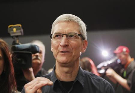 Apple CEO Tim Cook speaks in the demonstration room after the Apple event introducing the new iPad in San Francisco, California March 7, 2012. REUTERS/Robert Galbraith