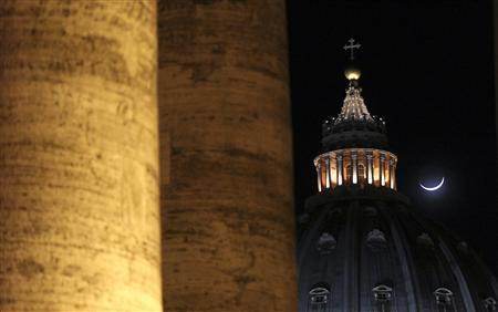 The moon rises near St Peter's Basilica at the Vatican February 12, 2013. REUTERS/Alessandro Bianchi