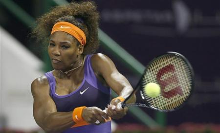 Serena Williams of U.S returns the ball to Daria Gavrilova of Russia during their women's match at the Qatar Open tennis tournament in Doha February 12, 2013. REUTERS/Fadi Al-Assaad