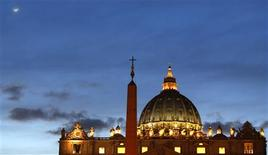 St Peter's Basilica is pictured at the Vatican February 12, 2013. Pope Benedict stunned the Roman Catholic Church on Monday when he announced he would stand down, the first pope to do so in 700 years, saying he no longer had the mental and physical strength to carry on. REUTERS/Alessandro Bianchi (VATICAN - Tags: RELIGION)