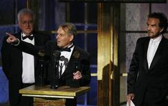 Lenny Davidson (C), Rick Huxley and Dave Clark (R), members of The Dave Clark Five, accept their awards during the 23rd annual Rock and Roll Hall of Fame induction ceremony at the Waldorf Astoria Hotel in New York in this file March 10, 2008 photo. REUTERS/Lucas Jackson