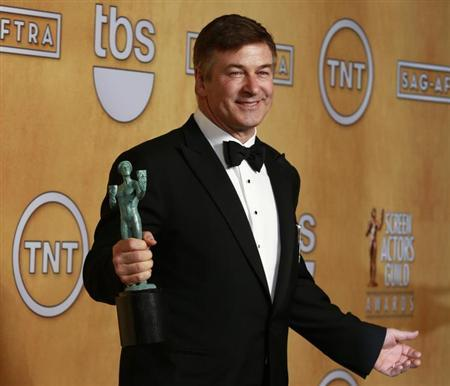 Actor Alec Baldwin holds the award for outstanding performance by a male actor in a comedy series for his role in ''30 Rock'' at the 19th annual Screen Actors Guild Awards in Los Angeles, California January 27, 2013. REUTERS/Adrees Latif