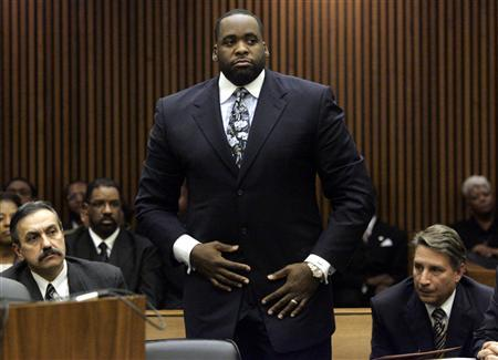 Former Detroit Mayor Kwame Kilpatrick stands in the courtroom during his sentencing hearing where he received 120 days in jail in Detroit, Michigan October 28, 2008. REUTERS/Rebecca Cook