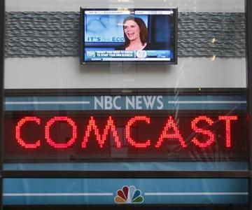 The news ticker outside the Today Show announces GE's sale of NBC to Comcast, in New York, in this December 3, 2009 file photo. Comcast Corp on Tuesday said it would buy General Electric's remaining 49 percent equity stake in their NBCUniversal joint venture for about $16.7 billion, speeding up a deal that had not been expected until at least late 2014. REUTERS/Chip East/Files