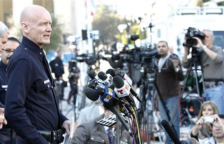 LAPD Commander Andrew Smith speaks to members of the media regarding fugitive Christopher Dorner outside LAPD headquarters in Los Angeles, California February 12, 2013. REUTERS/Mario Anzuoni