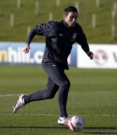 England's Frank Lampard runs with a ball during a training session at the St George's Park training complex near Burton Upon Trent, central England February 4, 2013. REUTERS/Phil Noble
