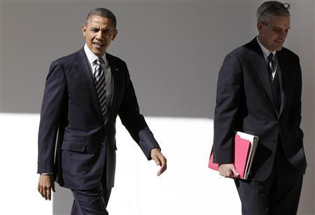 U.S. President Barack Obama (L) walks with Denis McDonough, the White House Chief of Staff, through the colonnade of the White House in Washington February 12, 2013. REUTERS/Yuri Gripas