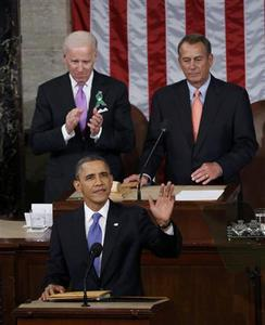 U.S. Vice President Joe Biden (L) applauds and House Speaker John Boehner (R-OH) looks on as President Barack Obama waves prior to delivering his State of the Union Speech on Capitol Hill in Washington, February 12, 2013. REUTERS/Kevin Lamarque