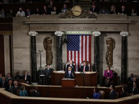U.S. President Barack Obama (C) starts to deliver his State of the Union Speech as Vice President Joe Biden (rear, L) and House Speaker John Boehner (R-OH) (rear, R) listen on Capitol Hill in Washington, February 12, 2013. REUTERS/Kevin Lamarque