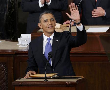U.S. President Barack Obama waves before delivering his State of the Union Speech on Capitol Hill in Washington, February 12, 2013. REUTERS/Kevin Lamarque
