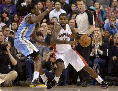 Toronto Raptors Amir Johnson (R) moves around Denver Nuggets Kenneth Faried during the second half of their NBA basketball game in Toronto February 12, 2013. REUTERS/Jon Blacker