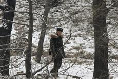 A North Korean soldier walks along the banks of Yalu River, near the North Korean town of Sinuiju, opposite the Chinese border city of Dandong February 12, 2013. REUTERS/Stringer