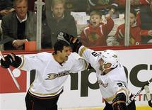 Anaheim Ducks' Andrew Cogliano (L) celebrates his goal with teammate Francois Beauchemin during the third period of their NHL hockey game against the Chicago Blackhawks in Chicago February 12, 2013. REUTERS/Jim Young